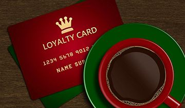 loyalty gift card and black coffee