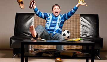 man excited over tv sports