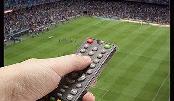 remote and sports tv