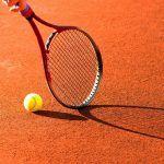 tennis raquet on clay court